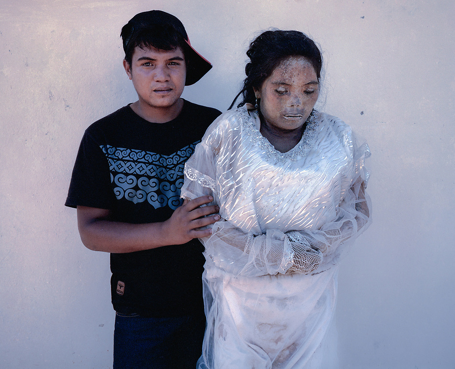 Gusti (21) with his mother, Sarce Limbong, who died in 2015 at age 43.<br /> <br /> Ma'nene is a tradition that takes place in August after harvest where the bodies of the dead loved ones are exhumed to be cleaned, groomed and dressed. For most, it's a bittersweet moment, a chance to reunite and physically see and touch and reconnect with loved ones who had passed on.