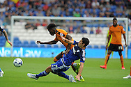Dominic Iorfa of Wolverhampton Wanderers is tackled by Peter Whittingham of Cardiff city.  Skybet football league championship match, Cardiff city v Wolverhampton Wanderers at the Cardiff city stadium in Cardiff, South Wales on Saturday 22nd August 2015.<br /> pic by Andrew Orchard, Andrew Orchard sports photography.