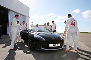 Glamorgan cricket players admire an Aston Martin Vanquish S car. Glamorgan CC media day and photocall at Aston Martin, St Athan, near Cardiff , South Wales on Thursday 6th April 2017.<br /> pic by Andrew Orchard, Andrew Orchard sports photography.