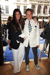 ELIZABETH SALTZMAN and HARRY BEECHER at the Ralph Lauren Wimbledon Party held at Ralph Lauren, 1 New Bond Street, London on 17th June 2010.
