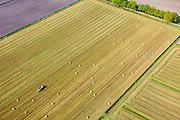 Nederland, Noord-Brabant, Gemeente Deuren, 27-05-2013; Kwadestaart - gemaaid gras wordt tot bollen geperst.<br /> Mown grass - hay bales.<br /> luchtfoto (toeslag op standard tarieven)<br /> aerial photo (additional fee required)<br /> copyright foto/photo Siebe Swart