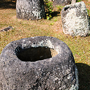 Some of the cylindrical stone jars at Site 3 of the Plain of Jars in north-central Laos. Much remains unknown about the age and purpose of the thousands of stone jars clustered in the region. Most accounts date them to at least a couple of thousand years ago and theories have been put forward that they were used in burial rituals.