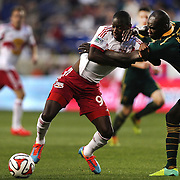 Bradley Wright-Phillips, (left), New York Red Bulls, is fouled by Pa Modou Kah, Portland Timbers, during the New York Red Bulls Vs Portland Timbers, Major League Soccer regular season match at Red Bull Arena, Harrison, New Jersey. USA. 24th May 2014. Photo Tim Clayton