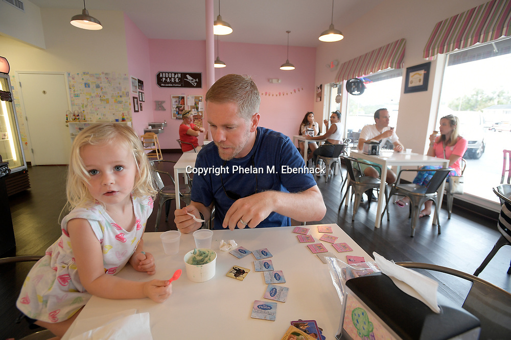 Jeff Sirolly shares a treat with his daughter, Lucia, 2, at Kelly's Homemade Ice Cream in the Audubon Park neighborhood  Saturday, Sept. 23, 2017, in Orlando, Fla. (Photo by Phelan M. Ebenhack)