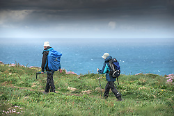Walkers on the cliffs at Carnewas at Bedruthan in Cornwall.