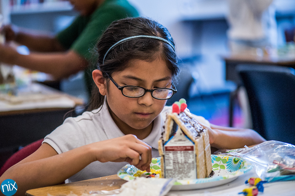 Shady Brook Elementary fourth-grader Jimena Cervantes designs her own gingerbread house in Alexandria Gordon's classroom Friday afternoon.