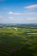 Nederland, Noord-Holland, Gemeente Ouder-Amstel, 25-05-2010. Amstelland, Polder de Rondehoep (ook Polder de Ronde Hoep), een van de grootste onbebouwde weidegebieden van de Randstad met karakteristiek stervormig kavelpatroon. Dit slotenpatroon van gerende verkaveling is ontstaan ten tijde van de ontginning in de middeleeuwen. Aan de horizon Amsteveen en Amsterdam Zuid-as..The Polder Rondehoep (or Polder Round Hoep), one of the largest undeveloped pasture area's in the Randstad with characteristic star-shaped pattern. This pattern is the result of the extraction during the Middle Ages..luchtfoto (toeslag), aerial photo (additional fee required).foto/photo Siebe Swart .The Polder Rondehoep (or Polder Round Hoep), one of the largest undeveloped pasture area's in the Randstad with characteristic star-shaped pattern. This pattern is the result of the extraction during the Middle Ages..luchtfoto (toeslag), aerial photo (additional fee required).foto/photo Siebe Swart