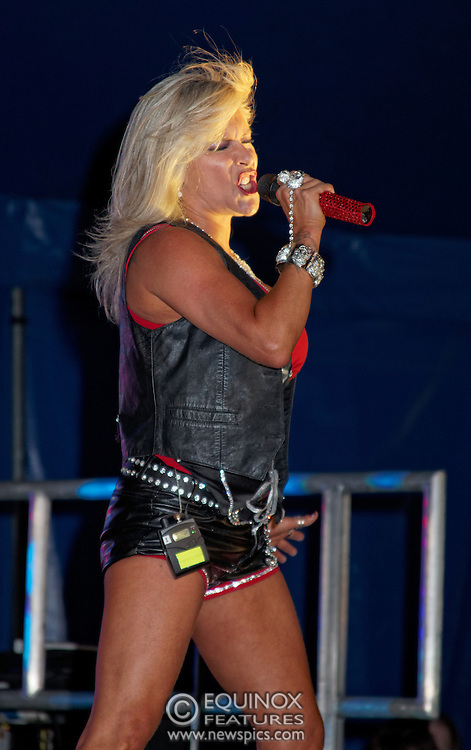 London, United Kingdom - 29 June 2013<br /> Gay Pride 2013 celebration. Singer and former Page 3 topless model Sam Fox performing at Summer Rites / Pride Party In The Park, Shoreditch Park, Hoxton, London, England, UK.<br /> Contact: Equinox News Pictures Ltd. +448700780000 - Copyright: ©2013 Equinox Licensing Ltd. - www.newspics.com<br /> Date Taken: 20130629 - Time Taken: 191012
