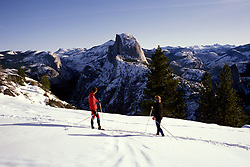 CA: Yosemite National Park, Cross Country Skiers, Skiing, model released, Half Dome in background, Winter      .Photo Copyright: Lee Foster, lee@fostertravel.com, www.fostertravel.com, (510) 549-2202.cayose209.