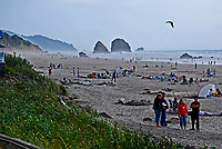 Haystack Rock, Cannon Beach, Oregon, USA, 200809010764, bathers, children, Pacific Ocean, rock, sea mist'<br /> <br /> Copyright Image from Victor Patterson, Belfast, UK<br /> <br /> t: +44 28 9066 1296 (from Rep of Ireland 048 9066 1296)<br /> m: +44 7802 353836<br /> <br /> victorpattersonbelfast@gmail.com<br /> <br /> www.victorpatterson.com OR <br /> www.images4media.com<br /> <br /> Please see my Terms and Conditions of Use at https://www.victorpatterson.com/page2<br /> It is IMPORTANT that you familiarise yourself with them.<br /> <br /> Images used on the Internet incur an additional cost and must be visibly watermarked i.e. © Victor Patterson within the body of the image and copyright metadata must not be deleted. Images used on the Internet have a size restriction of 4 kbs and are chargeable at rates available at victorpatterson.com.<br /> <br /> This image is only available for the use of the download recipient i.e. television station, newspaper, magazine, book publisher, etc, and must not be passed on to any third party. It is also downloaded on condition that each and every usage is notified within 7 days to victorpattersonbelfast@gmail.com.<br /> <br /> The right of Victor Patterson to be identified as the author is asserted in accordance with The Copyright Designs And Patents Act (1988). All moral rights are asserted.