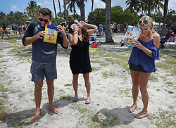August 21, 2017 - Florida, U.S. - Jupiter residents, JOEY HUEMPFNER, KIMBERLY WINDISH and ELAINE YOUNDT view the total solar eclipse at DuBois Park. (Credit Image: © Melanie Bell/The Palm Beach Post via ZUMA Wire)