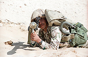 An Egyptian soldier patrols the sand berm marking the border of Kuwait and Saudi Arabia with a rocket-propelled grenade February 8, 1991 in Ruqa, Saudi Arabia. Egyptian soldiers are part of the coalition of nations in Operation Desert Storm to liberate Kuwait from Iraqi occupation.