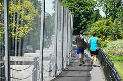 © Licensed to London News Pictures. 01/06/2019. LONDON, UK.  People pass by security fences installed around Winfield House in Regent's Park ahead of the State Visit of President Donald Trump.  Winfield House is the residence of the Ambassador of the United States of America to the Court of St. James's and will host the US President during his visit.  Photo credit: Stephen Chung/LNP