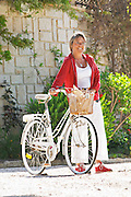 Susanne Wadesten in red and white on a bicycle Clos des Iles Chambres d'Hotes Bed and Breakfast Le Brusc Six Fours Cote d'Azur Var France