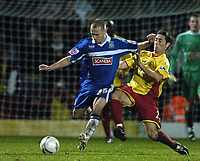 Photo: Jonathan Butler.<br />Watford v Stockport County. The FA Cup. 06/01/2007.<br />David Poole of Stockport fights with Tommy Smith of Watford