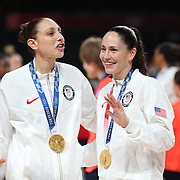 TOKYO, JAPAN August 8:  Five-time Olympic gold medalists Diana Taurasi #12 of the United States and Sue Bird #6 of the United States with their gold medals at the presentation ceremony after the team victory during the Japan V USA basketball final for women at the Saitama Super Arena during the Tokyo 2020 Summer Olympic Games on August 8, 2021 in Tokyo, Japan. (Photo by Tim Clayton/Corbis via Getty Images)