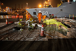 November 3, 2018 - Norht Jakarta, Jakarta, Indonesia - Jakarta, Indonesia, 03 November 2018 : Workers from Indonesian search and rescue give desinfectan to the fuselages of Lion Air Plane Crash. The fuselage was retrieved from Karawang Sea after crash. (Credit Image: © Donal Husni/ZUMA Wire)