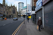 People wearing protective face masks in Birmingham city centre which is virtually deserted due to the Coronavirus outbreak on 31st March 2020 in Birmingham, England, United Kingdom. Following government advice most people are staying at home leaving the streets quiet, empty and eerie. Coronavirus or Covid-19 is a new respiratory illness that has not previously been seen in humans. While much or Europe has been placed into lockdown, the UK government has announced more stringent rules as part of their long term strategy, and in particular social distancing.