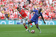 Chelsea's Victor Moses(15) and Arsenal's Alex Oxlade-Chamberlain(15) battle for the ball during the The FA Cup final match between Arsenal and Chelsea at Wembley Stadium, London, England on 27 May 2017. Photo by Shane Healey.