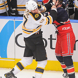 Boston Bruins left wing Milan Lucic (17) fights New York Rangers right wing Brandon Prust (8) during first period NHL action between the New York Rangers and the Boston Bruins at Madison Square Garden in New York, N.Y.