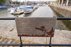 """© Licensed to London News Pictures; 07/06/2021; Bristol, UK. A commemorative plaque has been installed at the spot on the harbourside where the statue of slave trader Edward Colston was thrown into Bristol  docks one year ago today. The plaque was commissioned for the anniversary of the event by a group of 'guerrilla historians' and designed by Bristol artist John Packer. It features words from the poem """"Hollow"""" by former city poet Vanessa Kisuule and an engraving of the moment the statue was toppled from its plinth and thrown into Bristol Harbour by protesters on 07 June 2020 during a Black Lives Matter demonstration following the murder in the US of George Floyd a black man by a white police officer. The statue itself is being shown as it looked when it was retrieved from Bristol harbour at a temporary display in M Shed Museum with a survey by the We Are Bristol History Commission asking the city's citizens for their views on its long-term future. Photo credit: Simon Chapman/LNP."""