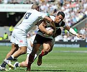 "Twickenham; GREAT BRITAIN;  Baa Baa's, Casey LAULALA, caring the ball is tackled by Englands', Jonathan JOSEPH, during the England vs Barbarians [Baa Baa's],  at Twickenham Stadium; Surrey on, Sunday  26/05/2013   [Mandatory Credit; ""Photo, Peter Spurrier/Intersport-images]"