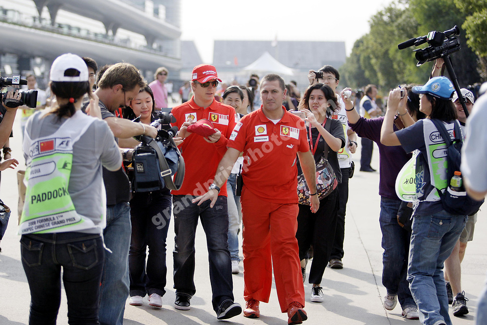 Kimi Raikkonen (Ferrari) surrounded by fans in the paddock before the 2008 Chinese Grand Prix at the Shanghai International Circuit. Photo: Grand Prix Photo
