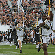 ORLANDO, FL - AUGUST 29: UCF players enter the stadium during a NCAA football game between the Florida A&M Rattlers and the UCF Knights on August 29 2019 in Orlando, Florida. (Photo by Alex Menendez/Getty Images) *** Local Caption ***