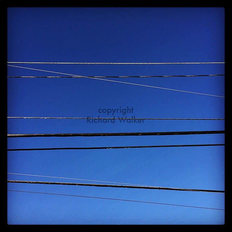 2016 January 10 - Wires and power lines against a blue winter sky, Seattle, WA, USA. Taken/edited with Instagram App for iPhone. By Richard Walker