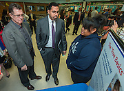 Houston ISD Superintendent Dr. Terry Grier, left, and Acting US Secretary of Education John King, center, tour the Apollo Market during a visit to Sharpstown High School, January 15, 2016.