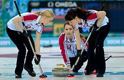 12-02-2014 CURLING: OLYMPIC GAMES: SOTSJI<br /> Japan verslaat Rusland met 8-4. Alexandra Saitova, Ekaterina Galkina, Anna Sidorova<br /> ©2014-FotoHoogendoorn.nl