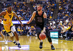 Mar 20, 2019; Morgantown, WV, USA; Grand Canyon Antelopes forward Michael Finke (43) drives during the first half against the West Virginia Mountaineers at WVU Coliseum. Mandatory Credit: Ben Queen