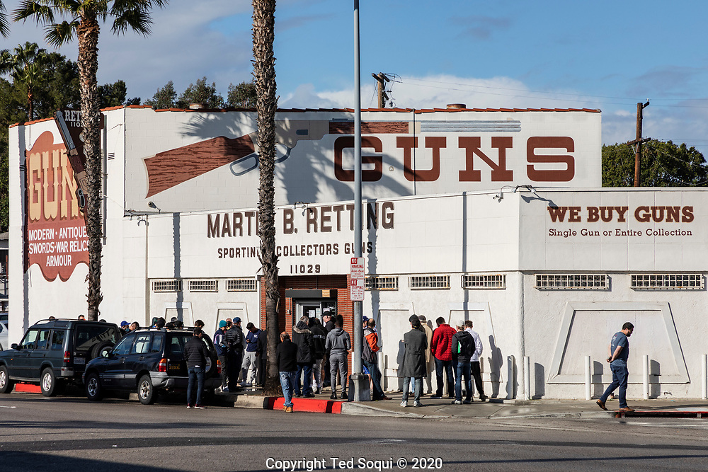 Lines of people waiting to go inside the Martin B. Retting gun store. The store was allowing 25 people inside at a time, wait times were up to several hours long. The shop was experiencing long lines over the last few days after the Covid19 virus began to outbreak in the Southern California area.<br /> 316/2020 Culver City, CA <br /> (Photo by Ted Soqui