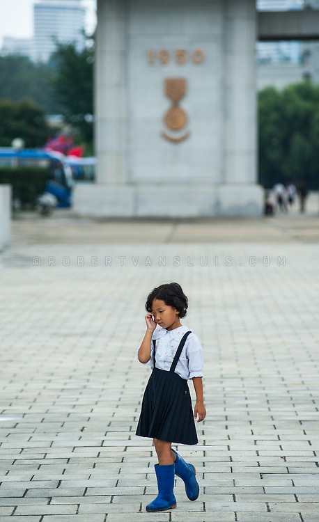 Young girl at the Monument to the Victorious Fatherland Liberation War, Pyongyang, DPRK (North Korea)