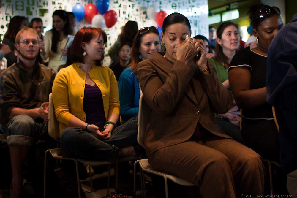 Dierdre Vernon wipes a tear as students and staff watch the inauguration of President Obama on a projector screen in the Loft at the University of California, San Diego.