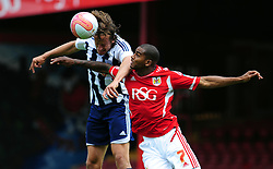Bristol City's Marvin Elliott battles for the high ball with West Bromwich Albion's Jonas Olsson - Photo mandatory by-line: Joseph Meredith / JMPUK - 30/07/2011 - SPORT - FOOTBALL - Championship - Bristol City v West Bromwich Albion - Ashton Gate Stadium, Bristol, England
