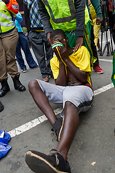 JOHANNESBURG, April 7, 2017  A wounded supporter of South African President Jacob Zuma wipes his tears in a march in Johannesburg,?South?Africa, on April 7, 2017.?South Africans on Friday marched across the country calling for President Jacob Zuma to step down while his supporters also marched in solidarity with him. (Credit Image: © Yeshiel Panchia/Xinhua via ZUMA Wire)