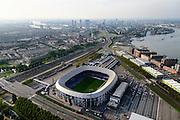 Nederland, Zuid-Holland, Rotterdam 28-09-2014; Rotterdam-Zuid, deelgemeente Feijenoord met het stadion Feijenoord ofwel 'De Kuip' van voetbalclub Feyenoord aan de Marathonweg (Limburg). Op de oever van de Nieuwe Maas komt in de toekomst de Sport Campus Stadionpark. Op dit sportpark komt ook het nieuwe stadion, 'de nieuwe Kuip aan de Maas'.<br /> Feijenoord, stadium 'De Kuip' of the football club Feyenoord to Marathonweg (r). Island Van Brienenoord and Van Brienenoordbrug in the background. Right of flats on the banks of the Nieuwe Maas, the location of the future Sports Park Campus Stadium.<br /> luchtfoto (toeslag op standard tarieven);<br /> aerial photo (additional fee required);<br /> copyright foto/photo Siebe Swart.