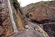 Route 103 in Peru over the Andes snakes down into the lowland jungles near the Alta Urubamba River in Peru. The road was traveled during the rainy season and there were many washouts and landslides. Image from the book project Man Eating Bugs: The Art and Science of Eating Insects.