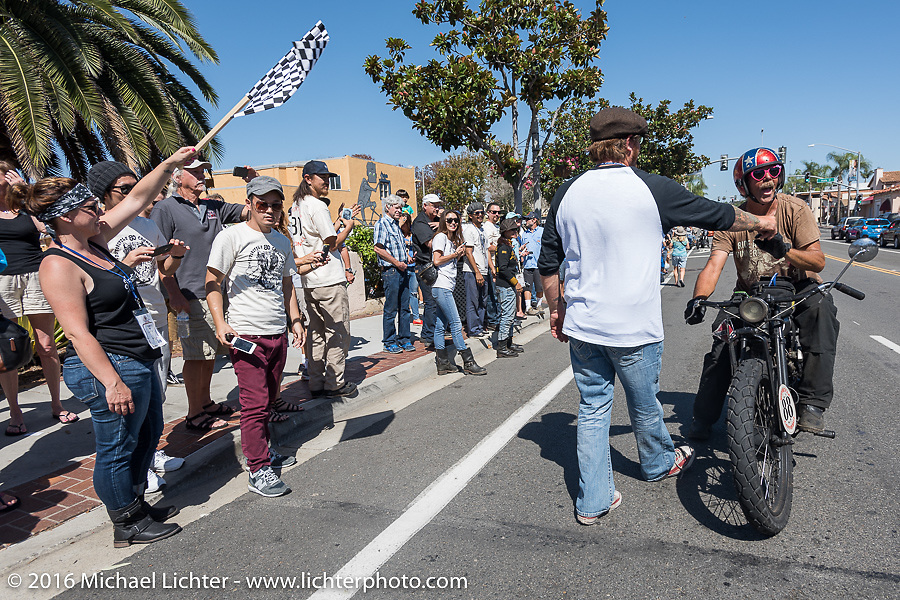 3,400 miles from the Atlantic to the Pacific - The journey is over. Doug Wothke of Alabama, an experienced long distance rider who has ridden a 1948 Indian Chief around the world as well as a 1962 Panhead chopper around the world, here riding his 1916 Indian crosses the finish line of the Motorcycle Cannonball Race of the Century. Stage-15 ride from Palm Desert, CA to Carlsbad, CA. USA. Sunday September 25, 2016. Photography ©2016 Michael Lichter.