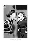 Children playing 'Snap Apple' on Hallowe'en night.<br /> <br /> 31st October 1952<br /> 31/10/1952