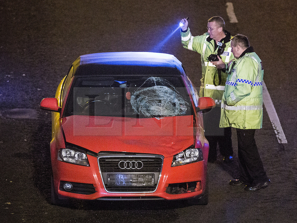 © Licensed to London News Pictures . 29/11/2014 . East Lancs Road , Salford , UK . Police investigate the scene of a fatal RTA on the A580 East Lancs Road this evening (29th November 2014) on the Westbound carriageway between Langworthy and Irlams o'th' Height turnoffs . A woman named as Jennifer Cross , 36 , from Salford , has died . Photo credit : Joel Goodman/LNP