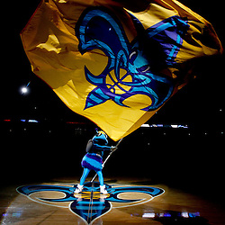January 18, 2012; New Orleans, LA, USA; New Orleans Hornets mascot Hugo waves a team flag before a game against the Memphis Grizzlies at the New Orleans Arena.   Mandatory Credit: Derick E. Hingle-US PRESSWIRE