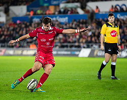 Dan Jones of Scarlets kicks a penalty<br /> <br /> Photographer Simon King/Replay Images<br /> <br /> Guinness PRO14 Round 11 - Ospreys v Scarlets - Saturday 22nd December 2018 - Liberty Stadium - Swansea<br /> <br /> World Copyright © Replay Images . All rights reserved. info@replayimages.co.uk - http://replayimages.co.uk