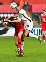 Football - 2019 / 2020 Sky Bet (EFL) Championship - Swansea City vs. Wigan Athletic<br /> <br /> , at the Liberty Stadium.<br /> Ben Wilmot of Swansea City collides with Kieran Dowell of Wigan Athletic<br /> COLORSPORT/WINSTON BYNORTH
