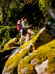 Women walking between rocks and woods in Vosges of Alsace at Lac Blanc, France