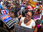 May 29 - PHOENIX, AZ: Some of the crowd at a pro-immigrant rights rally in Phoenix Saturday. Many marchers carried signs equating the Arizona law with Nazi Germany passbook laws. More than 30,000 people, supporters of immigrants' rights and opposed to Arizona SB1070, marched through central Phoenix to the Arizona State Capitol Saturday. SB1070 makes it an Arizona state crime to be in the US illegally and requires that immigrants carry papers with them at all times and present to law enforcement when asked to. Critics of the law say it will lead to racial profiling, harassment of Hispanics and usurps the federal role in immigration enforcement. Supporters of the law say it merely brings Arizona law into line with existing federal laws.  Photo by Jack Kurtz
