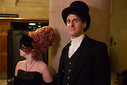 A man in a top hat with a woman with elaborate hairdo.