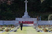 A female Canadian sailor looks at the graves of fallen servicemen and servicewomen with the Cross of Sacrifice in the background during the Remembrance Sunday ceremony at the Hodogaya, Commonwealth War Graves Cemetery in Hodogaya, Yokohama, Kanagawa, Japan. Sunday November 11th 2018. The Hodagaya Cemetery holds the remains of more than 1500 servicemen and women, from the Commonwealth but also from Holland and the United States, who died as prisoners of war or during the Allied occupation of Japan. Each year officials from the British and Commonwealth embassies, the British Legion and the British Chamber of Commerce honour the dead at a ceremony in this beautiful cemetery. The year 2018 marks the centenary of the end of the First World War in 1918.