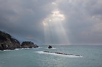 Light parts the clouds off the Italian coast near Monterosso al Mare